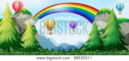 Balloons flying in the sky over mountains