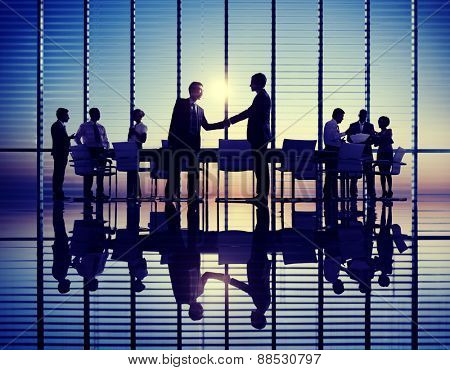 Group of Business People Meeting in Back Lit