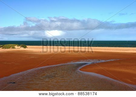Red earthed estuary and ocean at Carnarvon