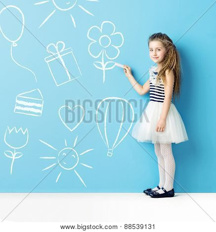 Little girl drawing different symbols