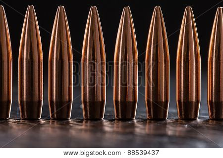 Macro shot of copper bullets that are in one row