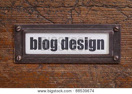 blog design  - file cabinet label, bronze holder against grunge and scratched wood