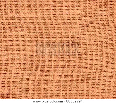 Atomic tangerine color burlap texture background