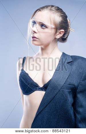 Beauty Concept: Proudly Looking Caucasian Female In Gray Suite Demonstrating Lingerie And Looking Do