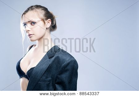 Portrait Of Sexy Sensual Caucasian Blond Model Dressed In Grey Modern Suite And Posing In Transparen