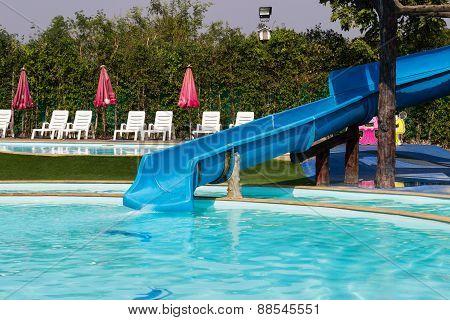 Slider Beside Swimming Pool