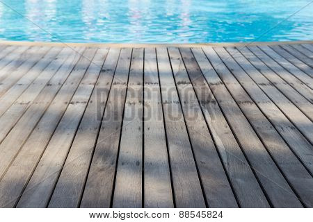 Wooden Floor Beside Swimming Pool