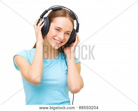 Young Woman With Headphones Listening To Music And Dancing - Isolated On White Background.