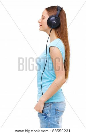 Profile Of Young Woman With Headphones Listening To Music - Isolated On White.