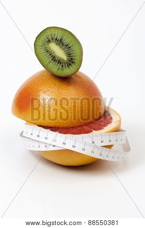 Half Sliced Red Grapefruit And Kiwi And Tape Measure Around