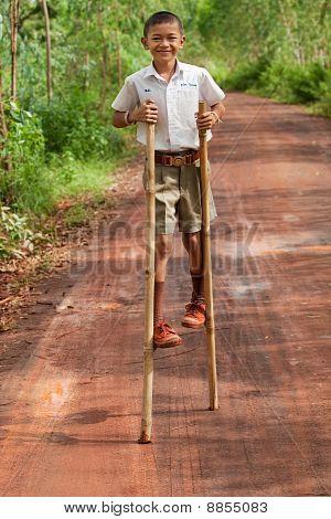 Boy Goes On Stilts