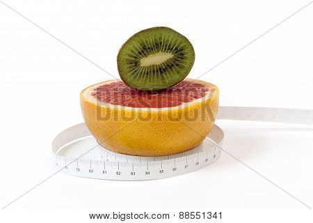 Red Grapefruit And Kiwi, Cut In Half And Tape Measure