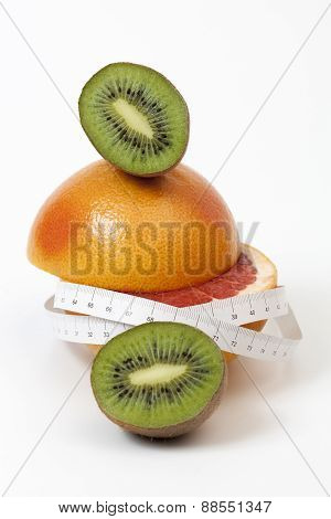 Red Grapefruit And Kiwi, Sliced In Half And Tape Measure