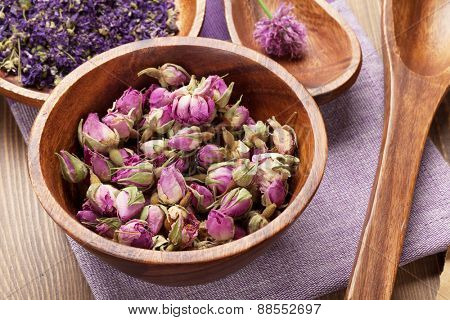 Purple spices and utensils over wooden table