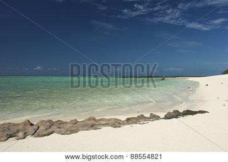 White sandy beach with rocks at Herron Island