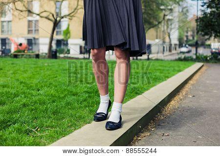 Woman Wearing A Skirt Walking In Park