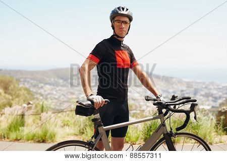 Male Athlete Taking A Break After Cycling Training Session