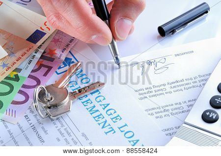 Client Signing A Mortgage Loan Agreement Rear View