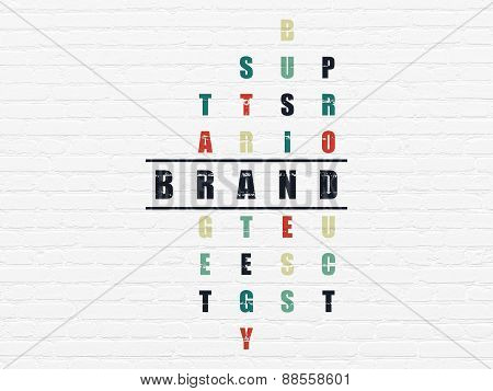 Advertising concept: word Brand in solving Crossword Puzzle
