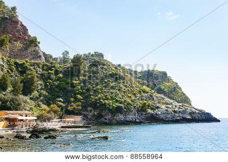 Pier On Isola Bella Beach Near Taormina Town