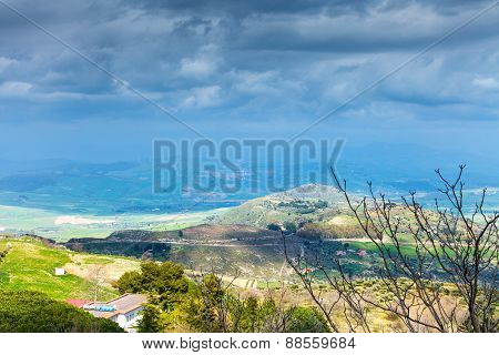 Rainy Clouds Over Green Sicilian Hills In Spring