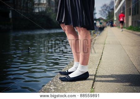 Young Woman Standing By A Canal