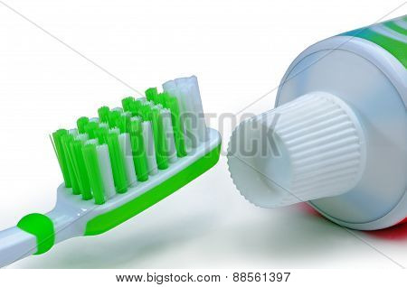 Green Toothbrush And Toothpaste Isolated On A White Background
