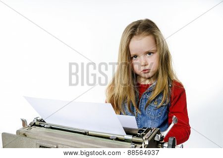 Cute Little Girl Typing On Vintage Typewriter Keyboard