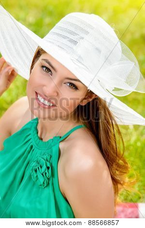Portrait of romantic young woman with beautiful smile outdoors. Summer day.
