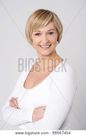 Confident Woman Posing Over Grey