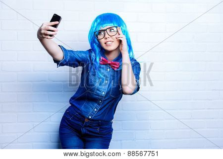 Selfie. Pretty teen girl taken pictures of her self. Beauty, fashion.