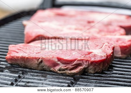 Fresh beef steaks on grill or BBQ