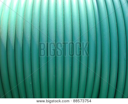 Plastic Green Rolled Up Hose Or Cable Wire