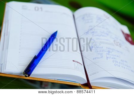 notebook with pen. depth of field. close-up