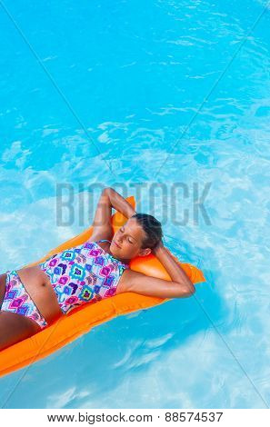 Girl relaxing in a pool