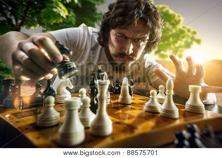 Serious man playing chess