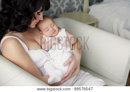 Portrait of a young mother with a newborn baby.