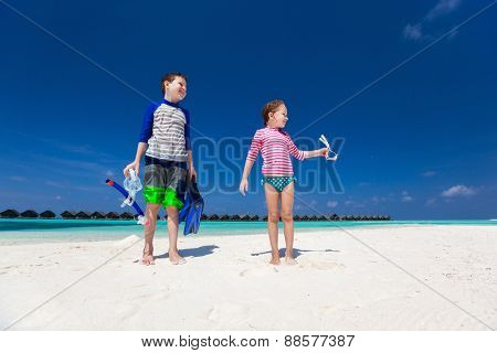 Kids having fun at tropical beach during summer vacation