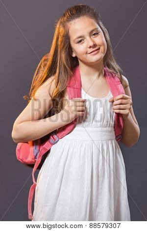 School child with a bag for school