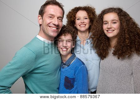 Happy Family With Son And Daughter Smiling Together