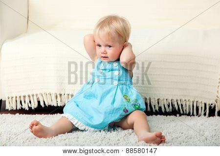 Little child is sitting on the floor