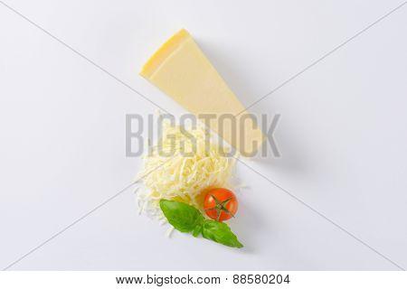 parmesan cheese, cherry tomato an basil on white background