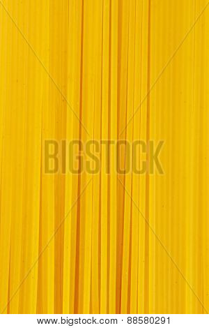 detail of uncooked spaghetti bundle backgrounds