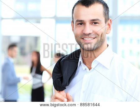 handsome confident young businessman smiling