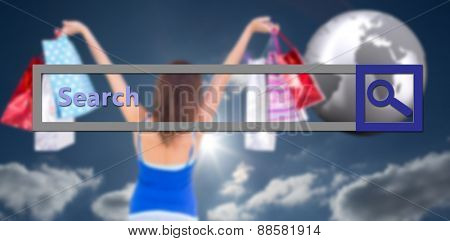 Rear view of a brunette woman raising shopping bags against sky