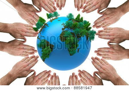Circle of hands against earth with forest