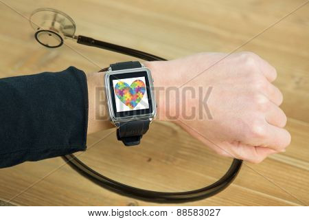 Businesswoman with smart watch on wrist against black stethoscope