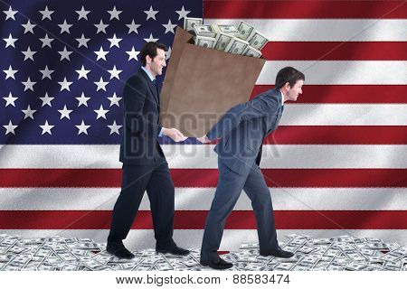Businessmen carrying bag of dollars against digitally generated american national flag