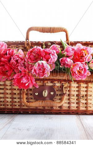 lovely picnic basket with pink tulips - food and drink