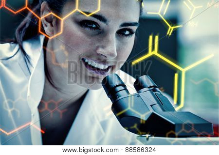 Science and medical graphic against young scientist posing with a microscope